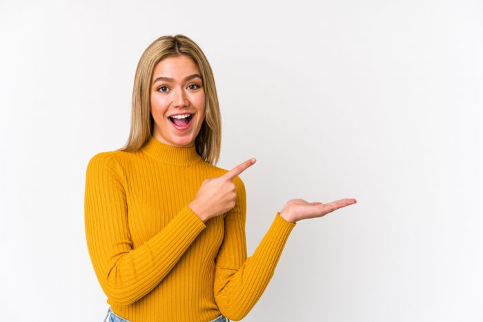 Young,Blonde,Caucasian,Woman,Isolated,Excited,Holding,A,Copy,Space