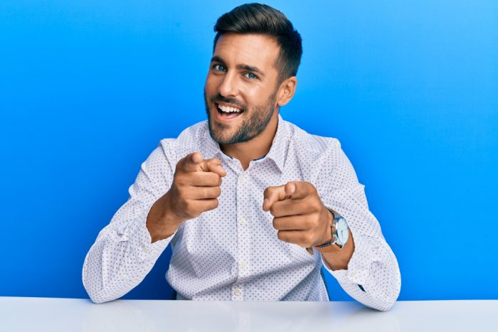 Handsome,Hispanic,Man,Wearing,Business,Clothes,Sitting,On,The,Table
