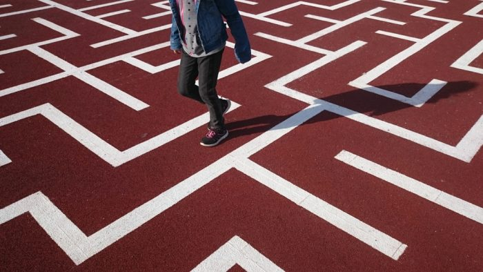 White,Maze,On,The,Floor.,Red,Asphalt,With,White,Straigt
