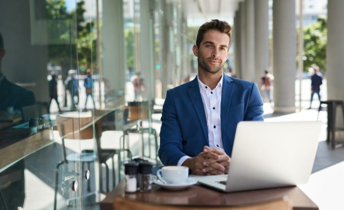 Portrait,Of,A,Focused,Young,Businessman,Working,On,A,Laptop
