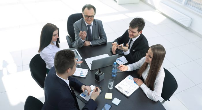 From,The,Top,View.business,Team,Discussing,A,Problem,With,A