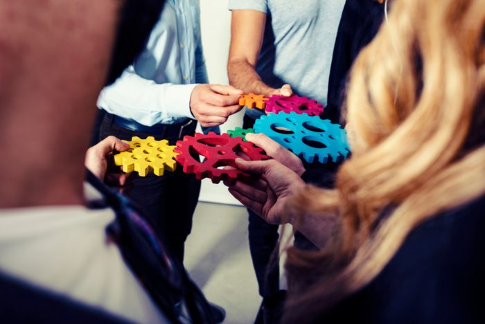 Business,Team,Connect,Pieces,Of,Gears.,Teamwork,,Partnership,And,Integration